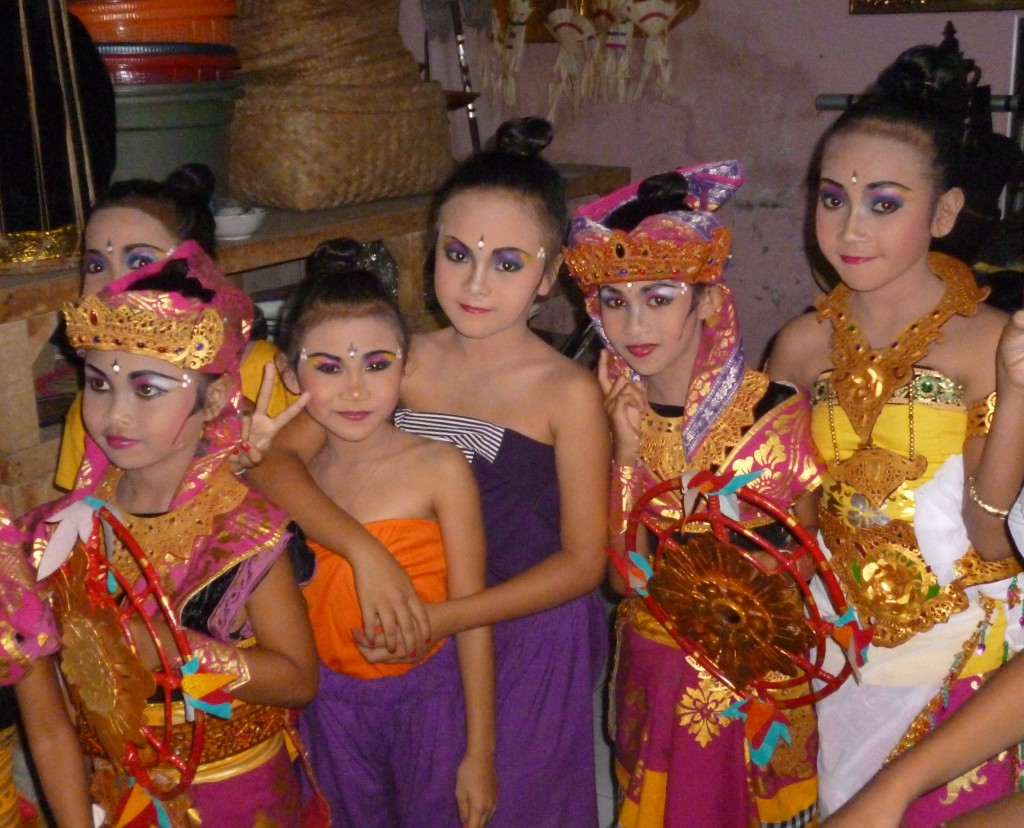 Children prepare for a dance competition in their home village
