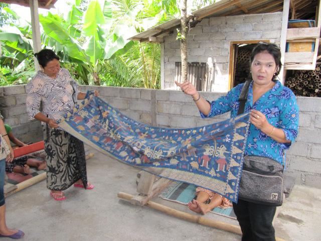 Weti and Ida Ayu explain ceremonial weaving.