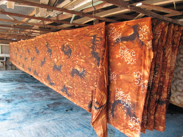 Wet fabric is hung on tiny nails to dry This is part of a fabric order for The Batik Butik… It is rayon designed primarily for apparel sewing… Some dyes require the sun to mature them which poses a challenge during the 6-month rainy season.