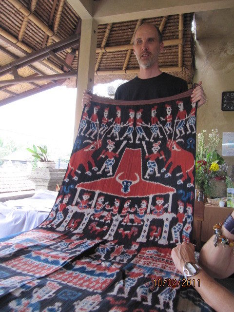 Threads of Life founder demonstrating storytelling ikat.
