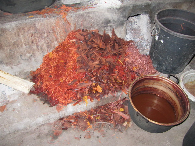 Root scrapings of the morinda tree that will be soaked, boiled, mashed and squeezed to produce dye. Only 1/4 of the root system is unearthed every year so the tree can recover and be used year after year.