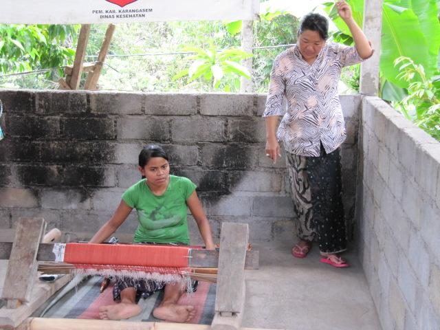 Silk ikat weaving on backstrap loom