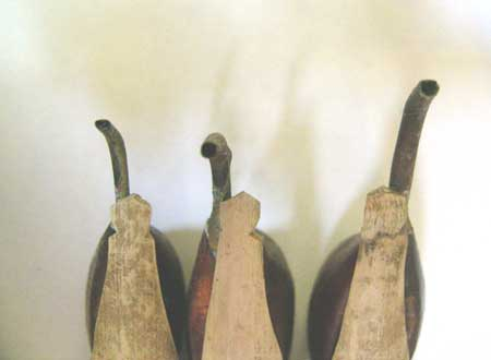 Tjanting tools have different sized spouts and several may be used on one piece of fabric.