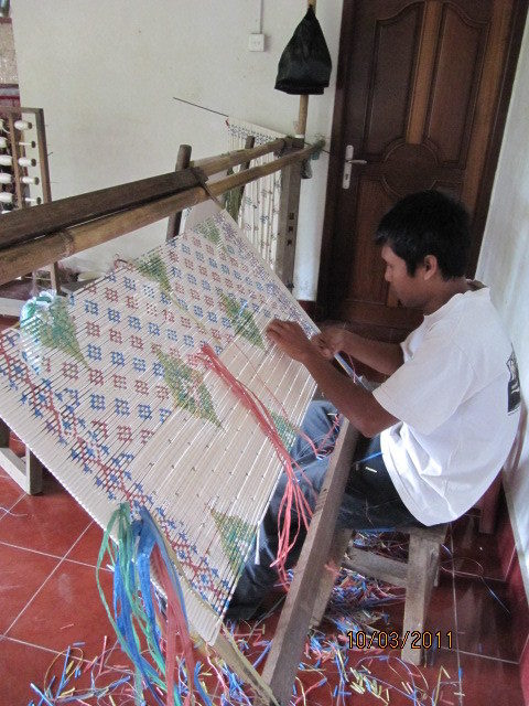 Ikat is a type of weaving where the pattern is pre-designed and the threads are pre-dyed. It is painstaking work.
