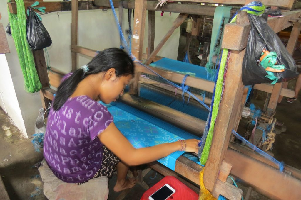woman weaving ikat fabric